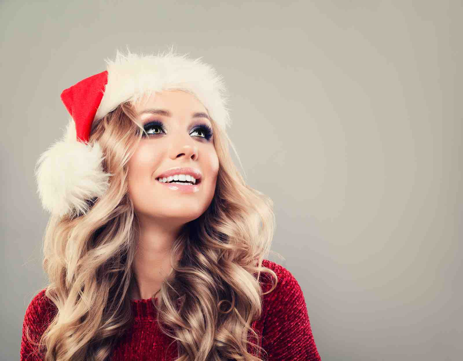 Christmas woman smiling with white straight teeth.